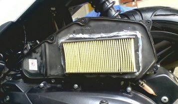 cek dan bersihkan filter motor